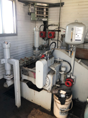 25hp triplex pump, housed in heated and skidded building